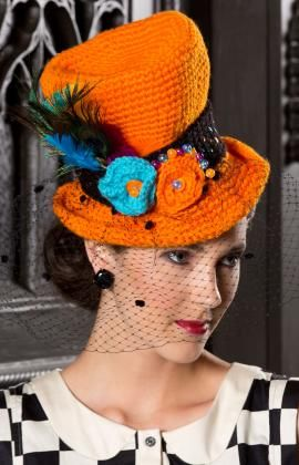 Halloween Top Hat - Look like you just stepped out of a cinematic film in this fetching crocheted top hat! Deck it out with crocheted flowers, sequins and netting as we did, or let your creativity go as wild as you please. free pdf