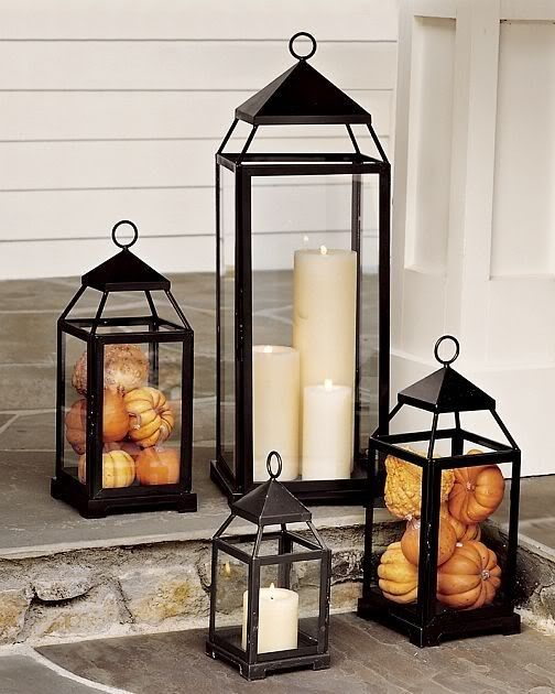 Lanterns decorated for an elegant Fall setting. These could be filled with mini pumpkins, acorns or leaves. #fall #home #decorations