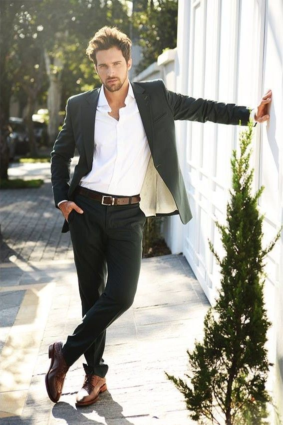 Tap into refined, elegant style with a black blazer and black suit pants. A pair of brown leather derby shoes brings the dressed-down touch to the ensemble.  Shop this look for $297:  http://lookastic.com/men/looks/dress-shirt-blazer-belt-dress-pants-derby-shoes/6015  — White Dress Shirt  — Black Blazer  — Dark Brown Leather Belt  — Black Dress Pants  — Brown Leather Derby Shoes
