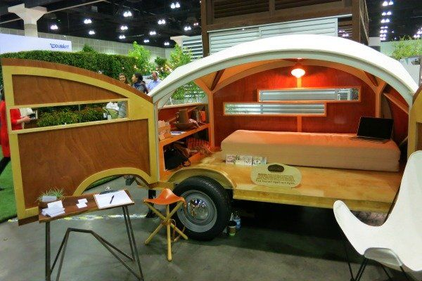 """The Hütte Hut """"teardrop caravan"""" portable camper is crafted from laser cut, marine grade plywood. Created in by a husband and wife team at Sprouting Sprocket Studio, it's the perfect size for a couple to get away for a weekend, and it opens up so wide you won't feel cramped inside.  Read more: http://www.doityourself.com/stry/dwell-on-design-2014-things-i-saw-that-you-want#.U6yy37Gr-t9http://www.doityourself.com/stry/dwell-on-design-2014-things-i-saw-that-you-want#.U6yy37Gr-t9#ixzz36bKuUf9G"""