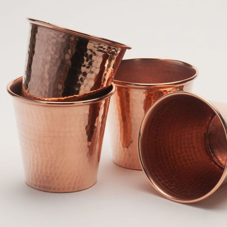 Hammered Copper Cups - Set of 4 | dotandbo.com. Pricy, but hey, they're copper, and heavy, and could be used for a lot of different things.