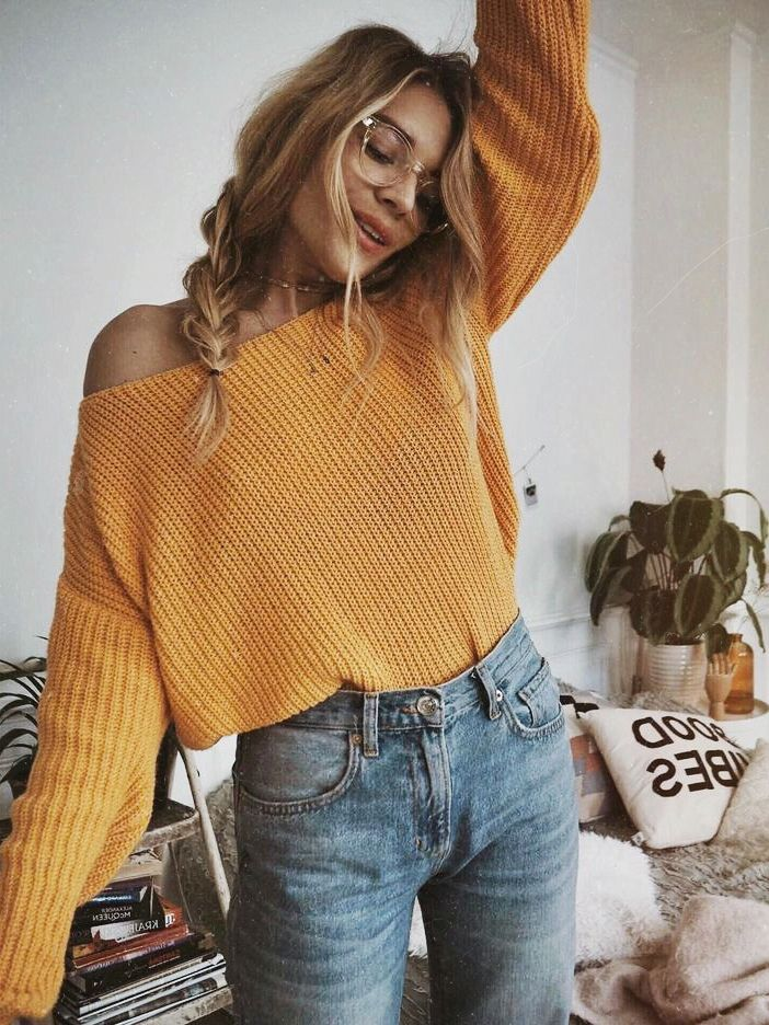 mustard yellow boat neck off the shoulder crop top sweater + high-waisted light wash boyfriend jeans