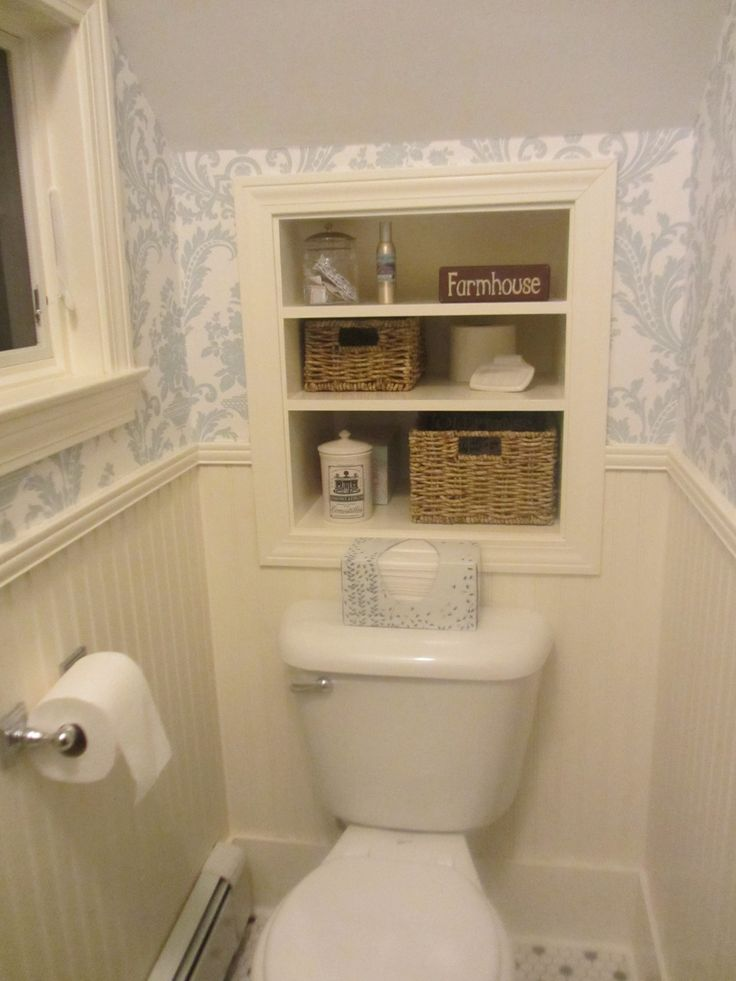 Understairs toilet with shelves