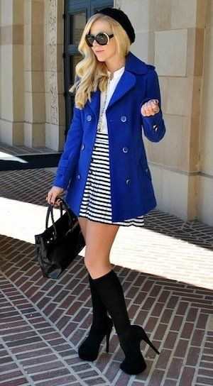 royal blue pea coat over black & white stripes w/ black boots & a black béret.