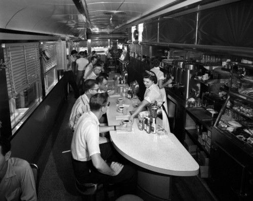 1950s Interior Of A Diner With Customers Seated At Counter