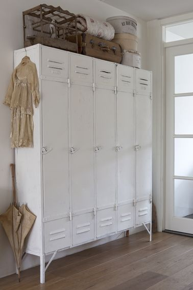 "Great Mudroom idea -- everyone gets their own ""locker"" and the clutter of coats and outerwear get tucked neatly away."