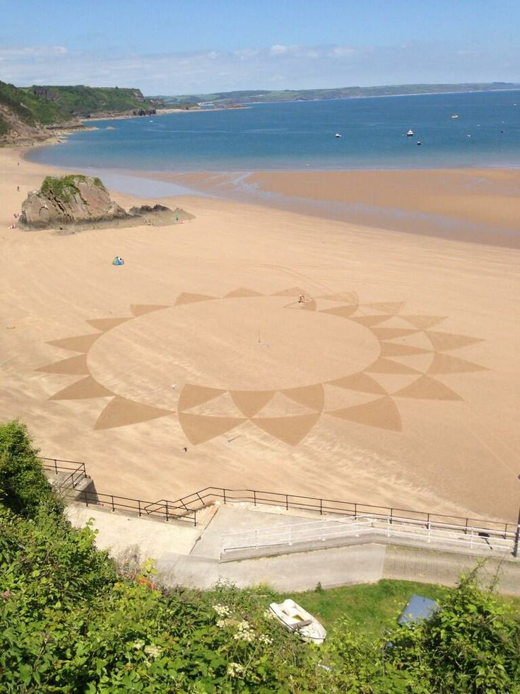 Sand art at Tenby , Wales