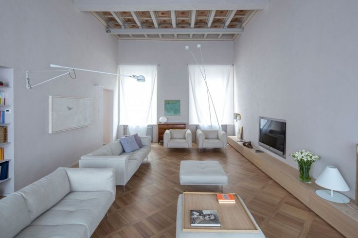 Apartment: Simply Brilliant Apartment In Piacenza Designed by Studio Blesi Subitoni, Apartment Interior Remodeling by Studio Blesi Subitoni with Beige Sofa Set and Ottomans and Wooden TV Bench also Drop Ceiling Tile and Wood Flooring and White Wall Color