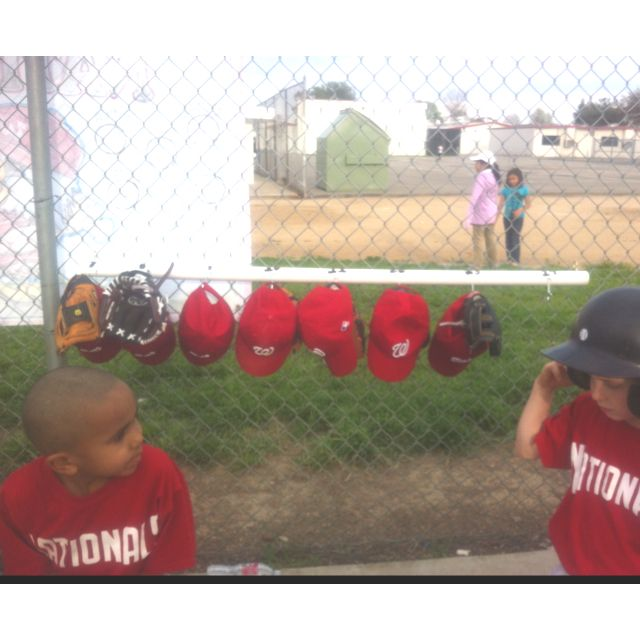 Tball, baseball, dugout hat and glove organizer I made. PVC pice and screw hooks and cup hooks