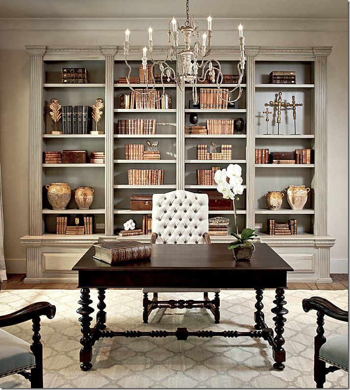 Houstonian Tami Owen created these shelves and I just love them.  She used the caramel colored antique books – in sets and singletons.  She mixed in a few pieces of water gilded antiques which look so great with the books.  Her shelves are very symmetric – two olive jars are matched with two olive jars.  Two boxes are balanced on neighboring shelves.