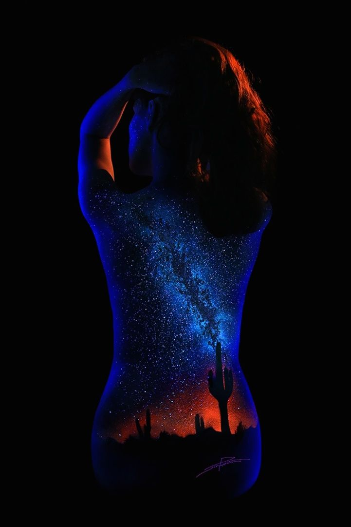 "The artist John Poppleton paints scenes from the natural world with fluorescent pigments on nude female models and photographs the results under ultraviolet lights. ""I like to call them 'modest nudes',"""