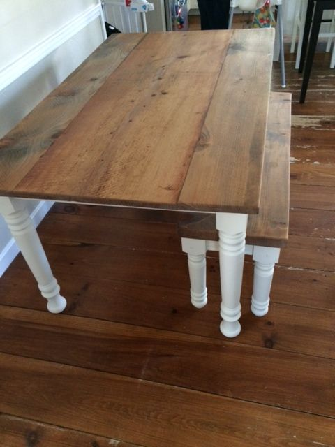 Wide Center Plank Farm Table With Light Stain And Waxed Finish Over Crisp  White Turned Legs