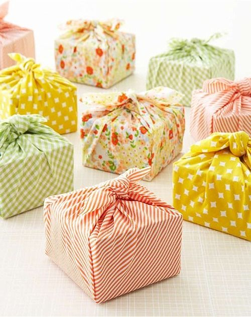 Gift wrap: cloth tied around gifts in fun prints (patterns) and color