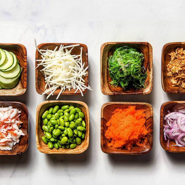 """The best poké bowls are made from only the freshest ingredients -- like sliced cucumbers, shredded jicama, house-made seaweed salad, """"chow"""" of miso-marinated Nameko mushrooms, crab salad, edamame, tobiko and red onions."""