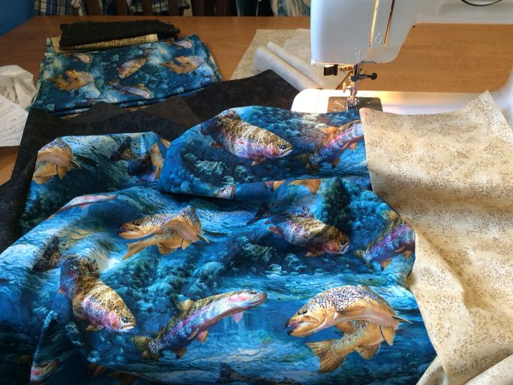 Here fishy fishy! Fabric getting sewn for quilt.