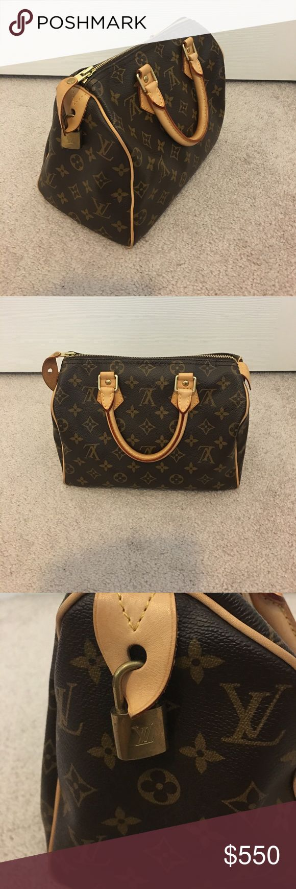AUTHENTIC Louis Vuitton Monogram Speedy 25 In excellent used condition. Includes original tags, lock and keys. Watermark on handle as shown in pic Louis Vuitton Bags
