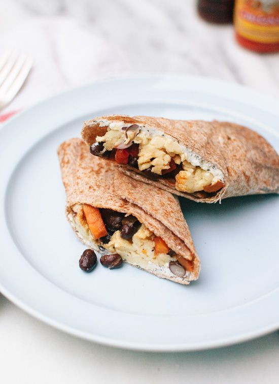 Healthy, vegetarian freezer breakfast burritos with sweet potato hash, black beans and scrambled eggs! Freeze extra burritos for busy mornings.