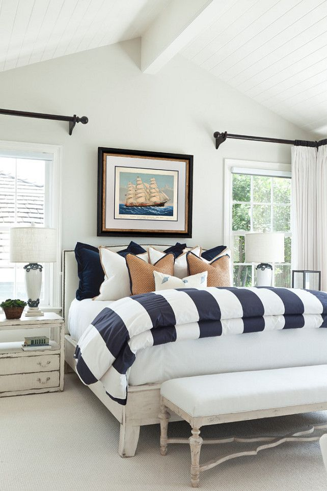 Beach House with Classic Coastal InteriorsBenjamin Moore Oyster shell 864.  {The entire main floor is painted in this gentle color}  Bedding was custom designed by the designer.
