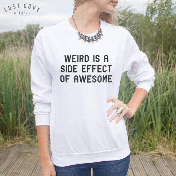 LostCoveApparel Weird Is a Side Effect of Awesome Jumper Sweater Funny... ($24) ❤ liked on Polyvore featuring tops, black, sweatshirts, women's clothing, hipster tops and black top