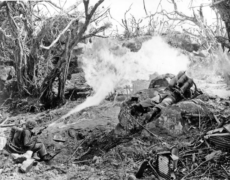 Striking images from the battle of Iwo Jima: Two U.S. Marines directing flame throwers at Japanese defenses that block the way to Iwo Jima's Mount Suribachi on March 4, 1945.