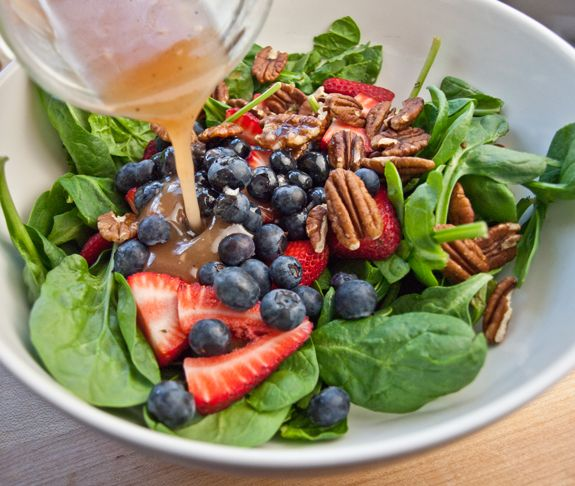 TESTED & PERFECTED RECIPE- Berries make an elegant addition to a savory salad of baby spinach, pecans and goat cheese dressed with a raspberry vinaigrette.