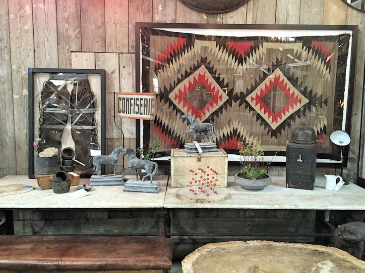 Navajo fabrics and vintage leather chaps hang on our wall, eclectic accessories to personalize the home.