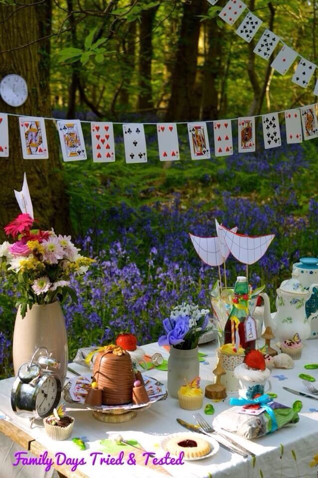 alice in wonderland. set up a table with flowers, bunting etc.