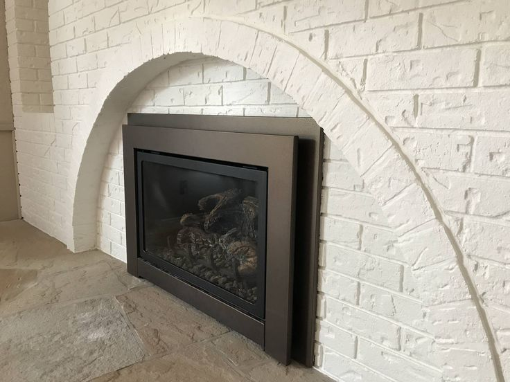 """Brick fireplace rolled not sprayed in Sherwin Williams Loxon-XP in Benjamin Moore """"Simply White"""""""