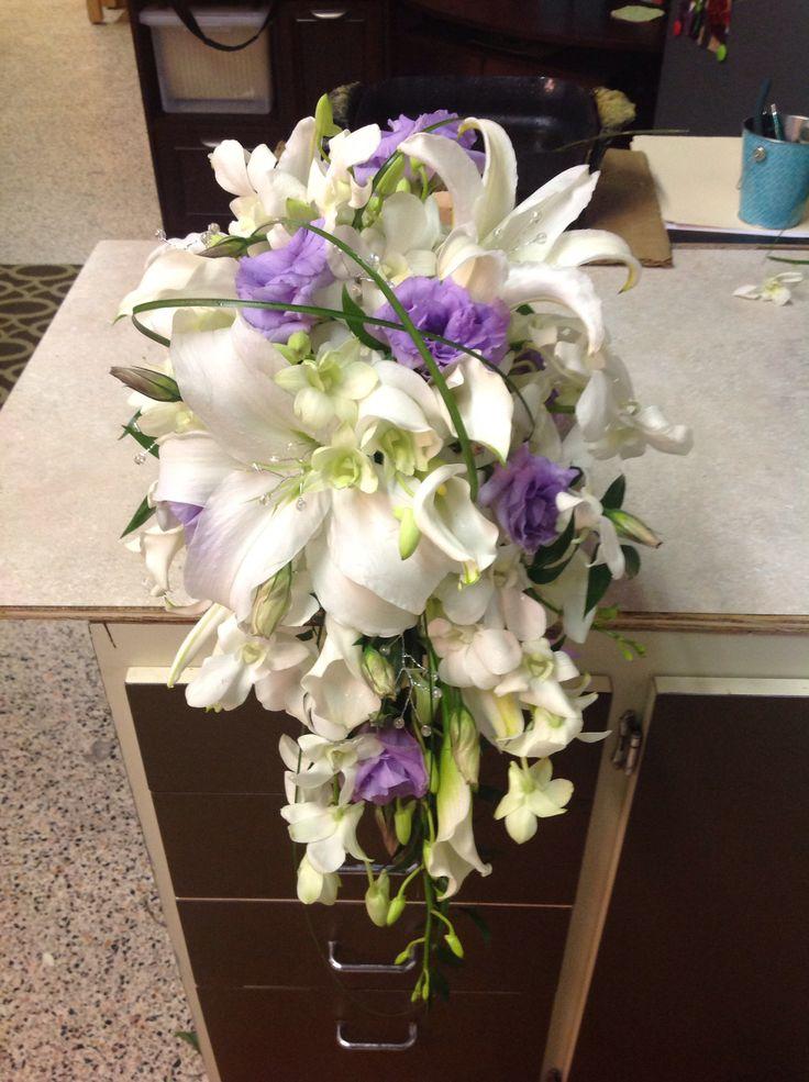 Close Up Of Cascade Wedding Bouquet White And Lavender Callas Dendrobiums Siberia