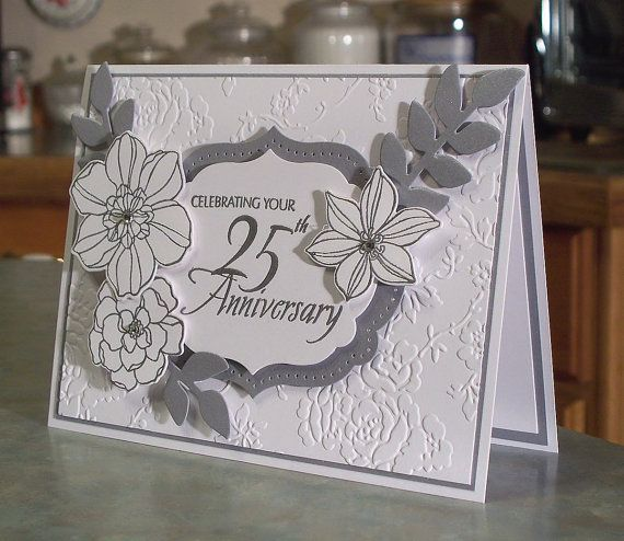 This beautiful handmade card will help you celebrate the happy couple that has been blessed with 25 years of marriage! The card measures 6 1/2 x 5 and was made using the Stampin Up Secret Garden stamp set and coordinating dies. Each flower is embossed in sterling silver embossing powder, then die cut. The leaves are die cut as well, using the beautiful Brushed Silver card stock from Stampin Up. The phrase is heat embossed in sterling silver as well, die cut and popped onto a layer of die cut…