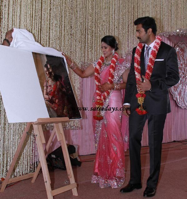 checkout sneha in pink bridal saree at her wedding reception. Pink netted  bridal saree with