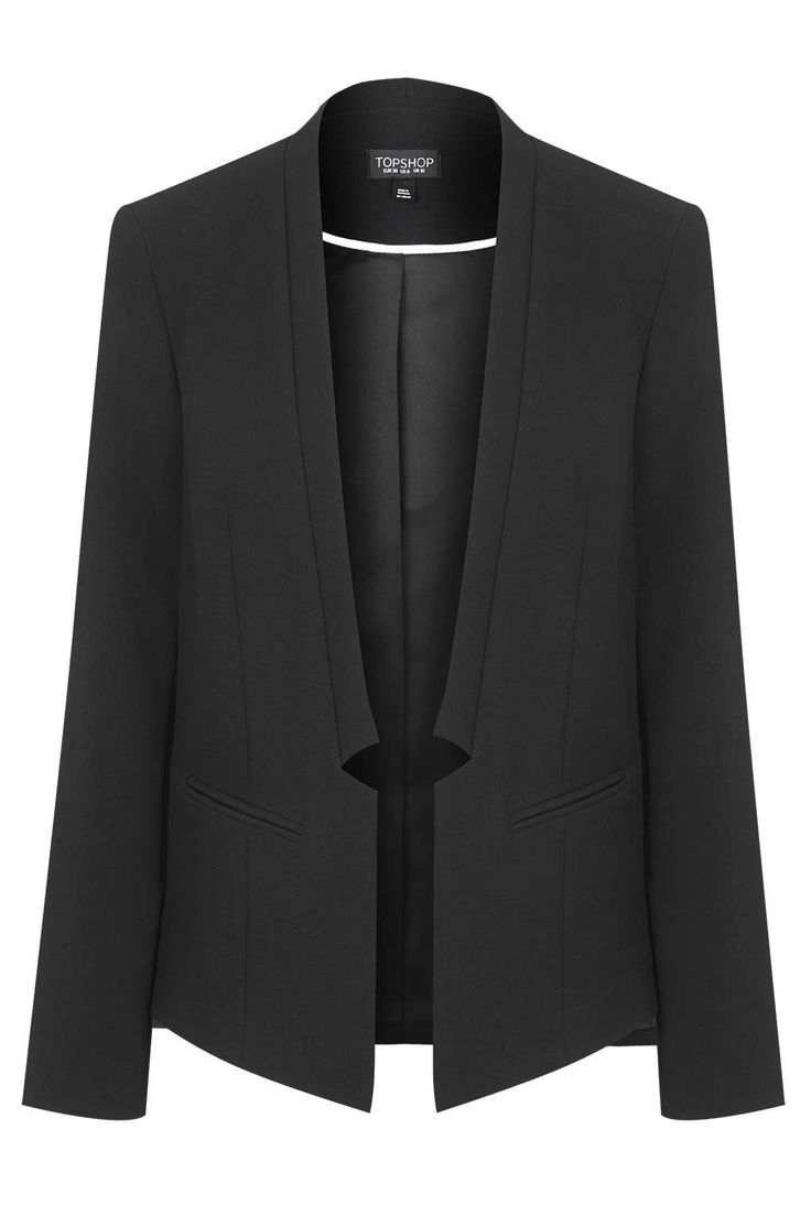 Notch Blazer: A staple item to put over any dress. The notch detail sets this aside from your average blazer and with no buttons, collar or obvious lapels, this garment is provides a more modern aesthetic.