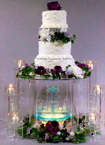 3 Tier Wedding Cake Structure with a fountain and candles ...