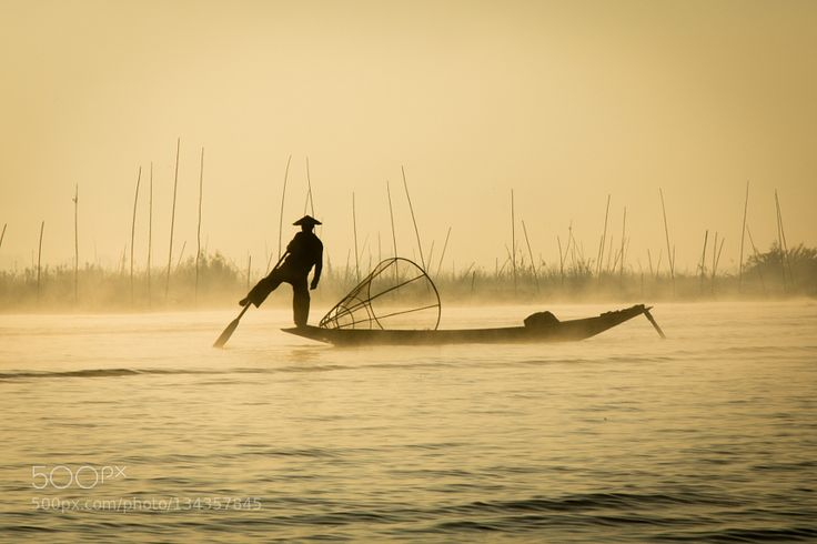 Popular on 500px : Inle Lake fisherman by ChrisMannolini