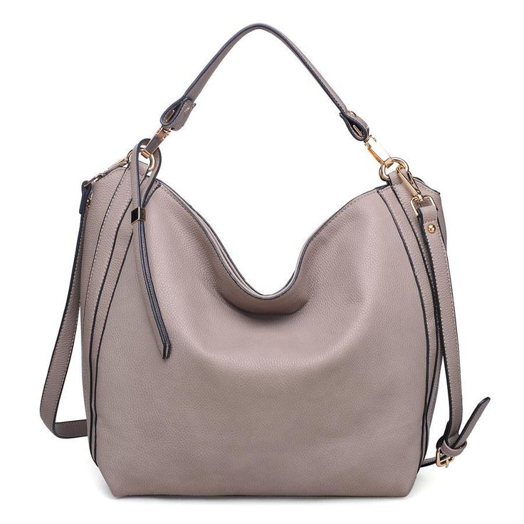 Slouchy pebbled hobo style with top zipper closure Extended zipper pull detail Interior has slide pockets and zip pocket Light gold and silver hardware accents Includes detachable, adjustable crossbod