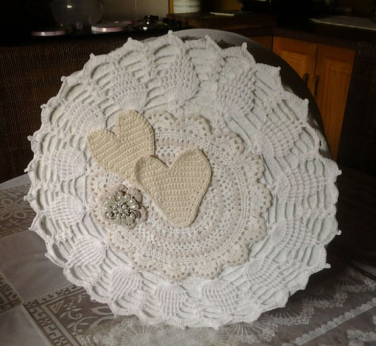 Hatbox with crochet pieces and brooch