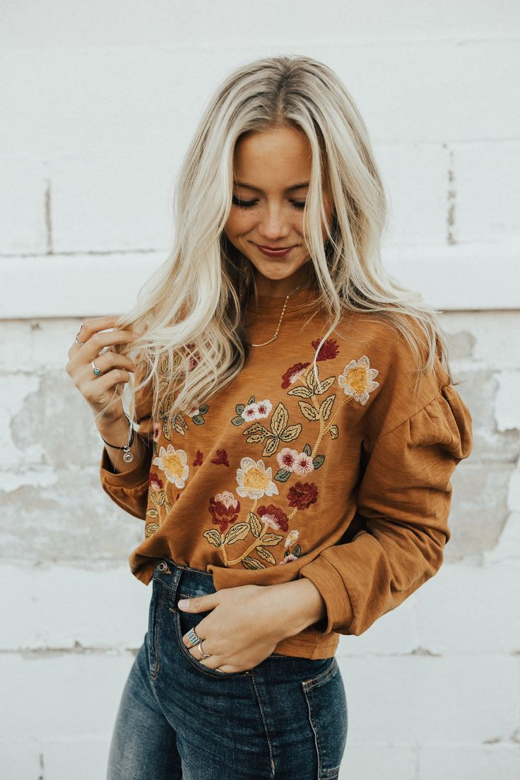 "Camel Long Sleeve Top Dropped Shoulder Sleeve Floral Embroidered Front Gathered Shoulder Seam Loose Sleeves Round Neck View Size Chart Model is 5'9"" + Wearing a Small"