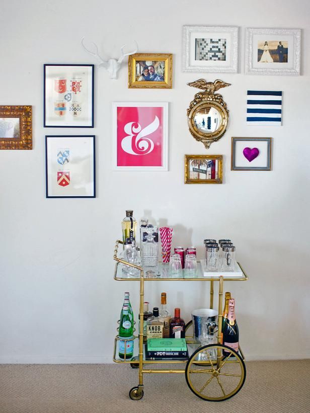 Traditional gilded frames look modern when paired with a sleek golden bar.   http://www.hgtv.com/entertaining/how-to-style-a-bar-cart/pictures/page-4.html#?soc=Pinterest
