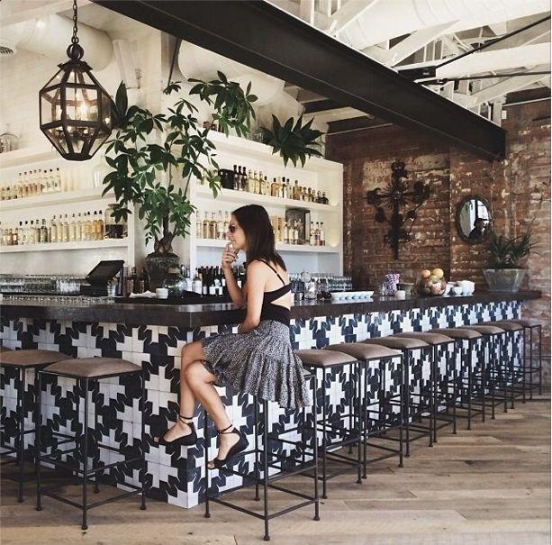 bar design - patterned tiles, brick and metal - planted