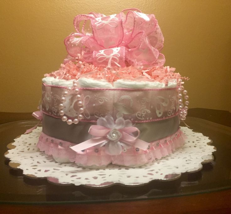 Beautiful pink and gray diaper cake -one tier diaper cake -elegant and delicate diaper cake - http://www.babyshower-decorations.com/beautiful-pink-and-gray-diaper-cake-one-tier-diaper-cake-elegant-and-delicate-diaper-cake.html