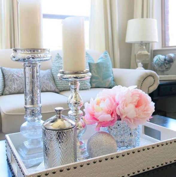 Coffee table decor inspiration. White trays for the coffee table. Pink peony flower arrangement. Pink peonies for the living room. Flower arrangements for the home. White and silver home decor inspiration. White and silver candles candles. White sofa inspiration. Thompson Ferrier silver candle.