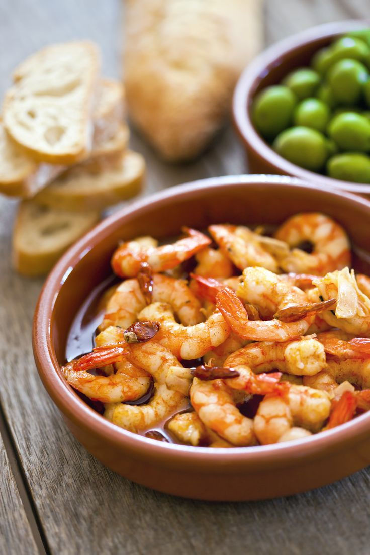 """Oh ...my ....yum!! . """"Gambas al ajillo"""", or garlic shrimp, is a simple Spanish dish that can really impress! With only a handful of ingredients, the flavor of each component is truly highlighted, so a great olive oil is essential for the success of this appetizer.This Spanish tapas dish comes out in a sizzling plate with fruity olive oil. It's ABSOLUTELY delicious!"""