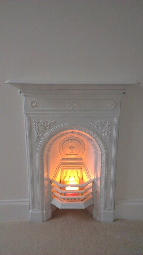 Painted cast iron fireplace for nursery