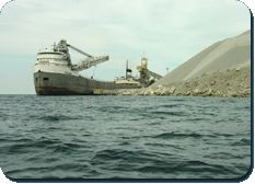 Located about six kilometres from the village, at the water's edge on the western shore of the Island, is the largest quarry operation in Canada.  The Lafarge Quarry produces dolomite used in concrete, road construction and metallurgical processing, and all of their product leaves the area on huge ocean-going freighters.