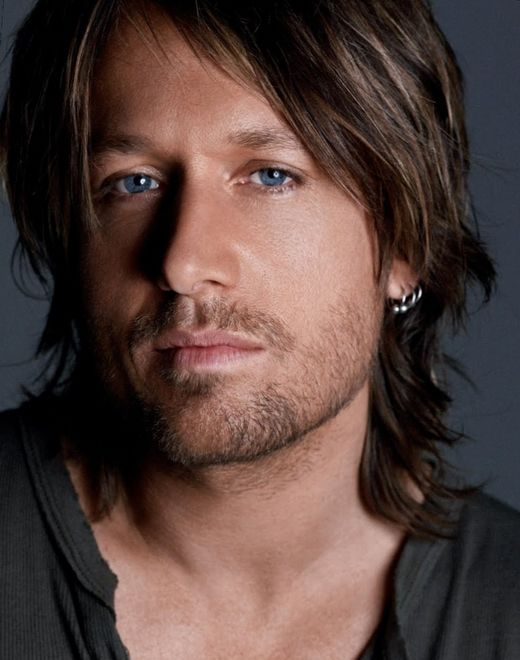 Kieth Urban's longer style is roughed up, edged out and deconstructed. If your hair is longer and you just don't know what to do with it, if you're willing to use a little bit of product, this might be the style to try.