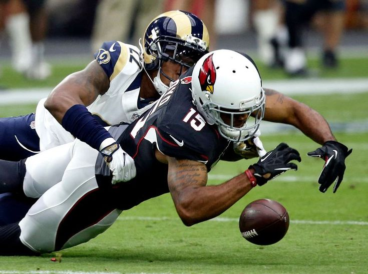Rams vs. Cardinals Updated October 2, 2016: 17-13, Rams - Los Angeles Rams cornerback Trumaine Johnson (22) breaks up a pass intended for Arizona Cardinals wide receiver Michael Floyd (15) during the first half of an NFL football game, Sunday, Oct.
