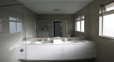 Ensuite vanity, CaesarStone Organic White, undermount basin, floor to ceiling tiling, wall to wall to ceiling mirror.