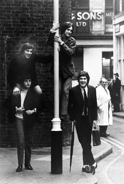 """The centre of London's fashion world is now in the east, but in the mid-60s Carnaby Street was where it was at. So much so that in 1966 The Kinks (pictured here in Soho, 1965) wrote 'Dedicated Follower Of Fashion', poking fun at the """"Carnebetian army"""" - the fashion victims who thronged Carnaby Street. Photo: Getty"""