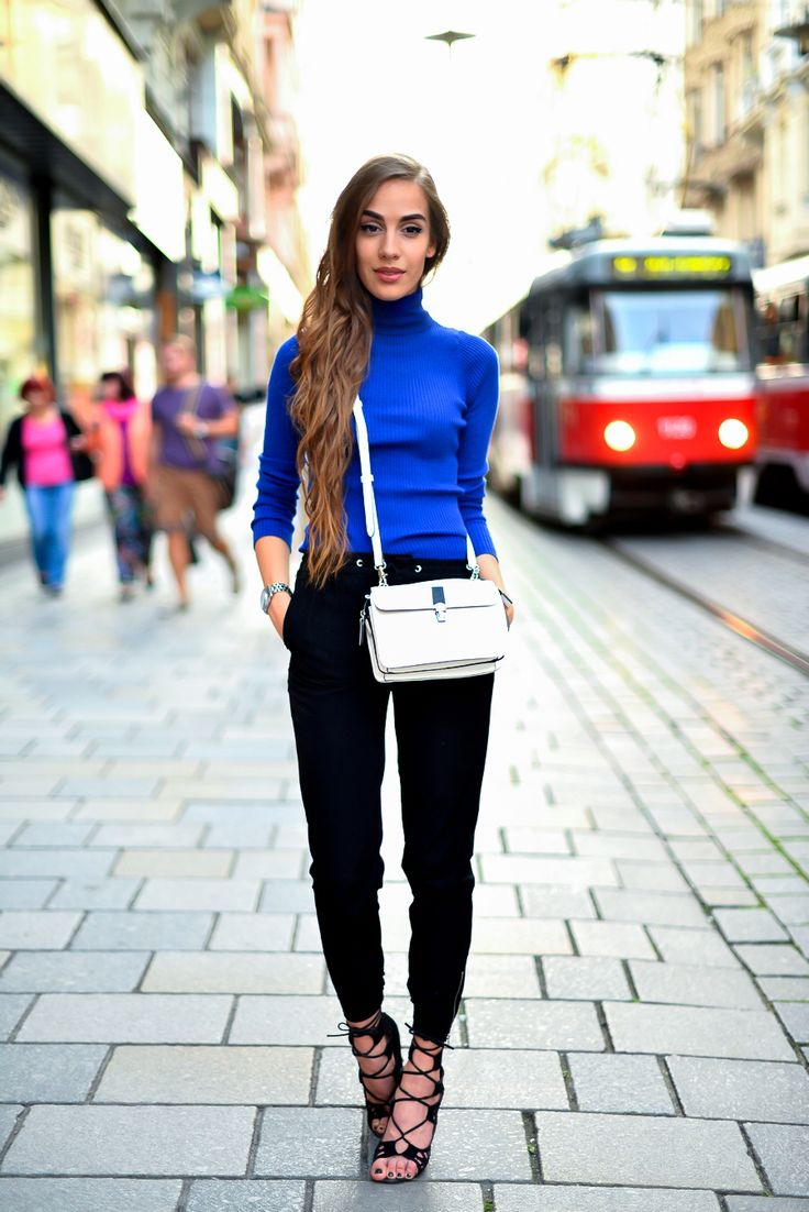 Shop this look for $114:  http://lookastic.com/women/looks/blue-turtleneck-and-white-crossbody-bag-and-black-skinny-pants-and-black-heeled-sandals/3599  — Blue Turtleneck  — White Leather Crossbody Bag  — Black Skinny Pants  — Black Suede Heeled Sandals
