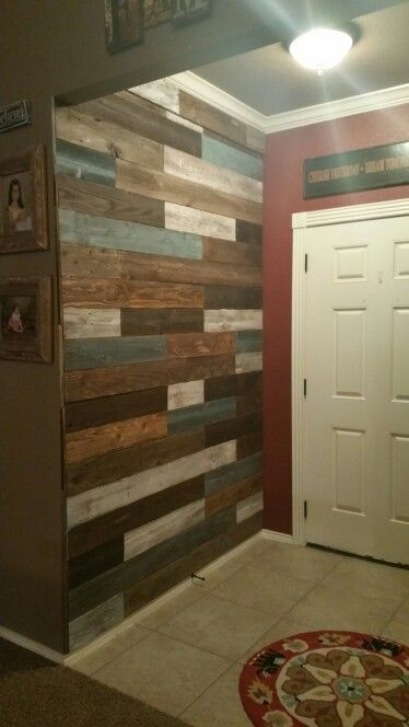 Pallet wall made from old fencing. Each board stained and cut to make random pattern.